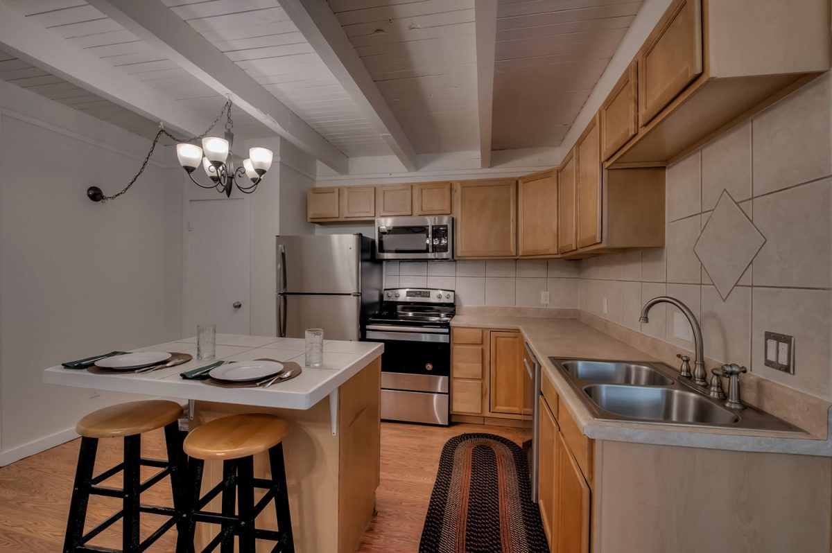 Kitchen and Center Island - Treehouse A-206 Wildernest Condo for Sale